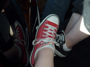 Red Chucks for everyday wear, and black sueded Chucks for dancing.