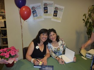 Erin and Tami Stevens sign copies of 'Swing Dancing.'